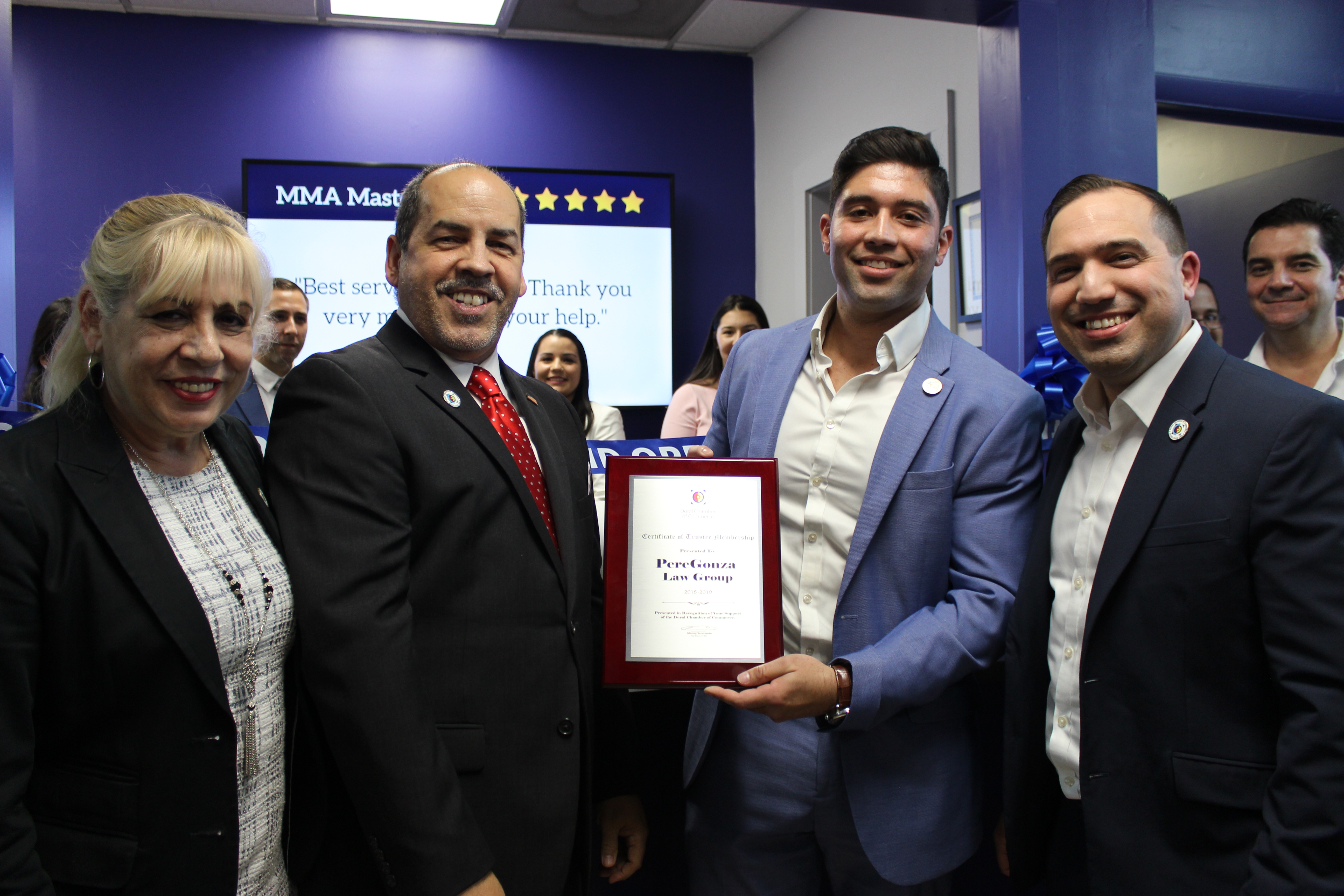 Best of Doral™ plaque being given to PereGonza Law.